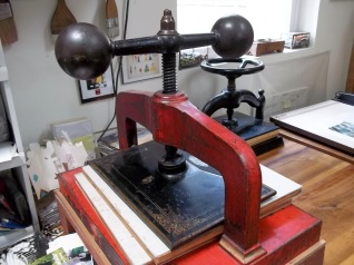 This is her antique paper press, which was painted battleship gray when she found it. She uncovered this wonderful object with a lot of hard work.