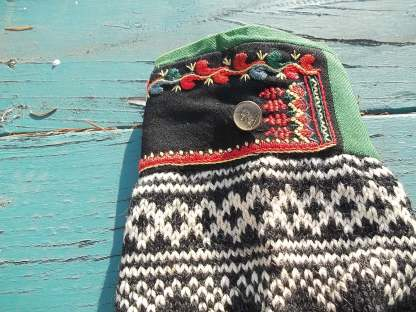 The cuff of my grandmother's Norwegian sweater, with an adorable unicorn button.